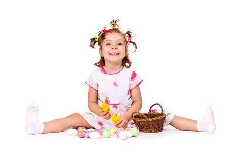 Sweet kid playing with Easter eggs photo