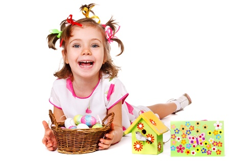 Laughing girl with spring greeting card, nesthouse and Easter eggs photo