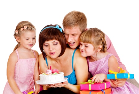 Family blowing out candle fire on birthday cake photo