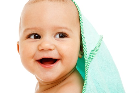 Laughing infant covered with towel