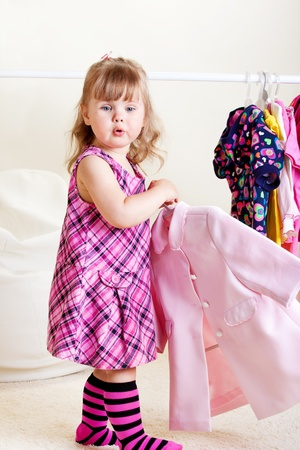 designer baby: A cute blond toddler girl shopping Stock Photo