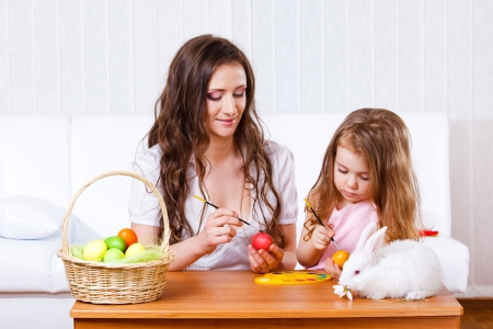 Mother and daughter painting Easter eggs photo