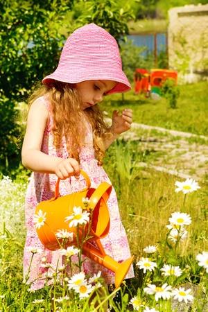 Girl in sunny summer garden