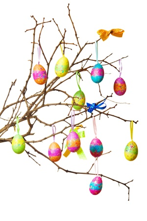 hanging flowers: Easter branch with colorful eggs and bows on it