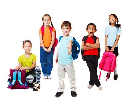 Primary school students with backpacks Foto de archivo