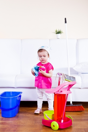 big bin: Little girl tidying the room