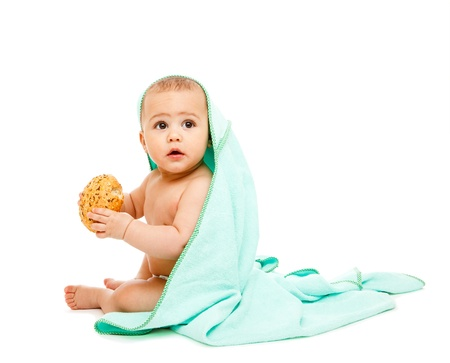 Baby in towel with bun in hands photo