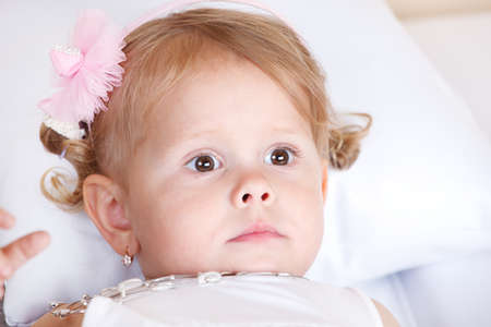 Thoughtful toddler girl lying Stock Photo - 13138326
