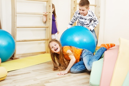 large ball: Elementary students having fun in gym