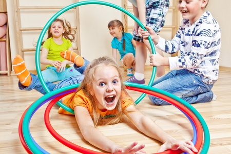 school gym: Emotional kids having fun in gym Stock Photo