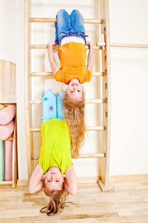 Two cheerful girls upside down Stock Photo - 13138879