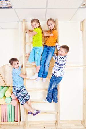 Sportive kids climbing on wall bars Stock Photo - 13191232