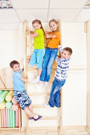 wall bars: Sportive kids climbing on wall bars