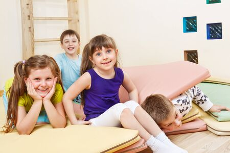 tumbling: Cheerful kids playing with tumbling mats
