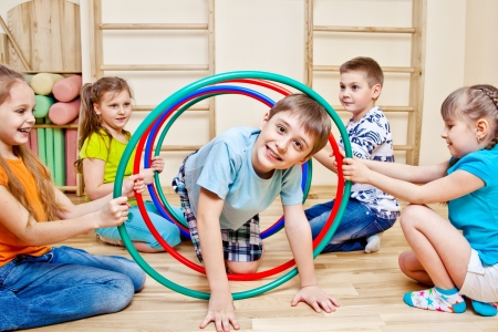 hoops: Children playing in school gym Stock Photo