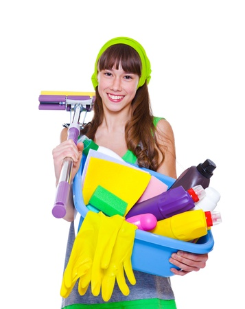 housecleaning: Cheerful teen holding detergents and mop Stock Photo