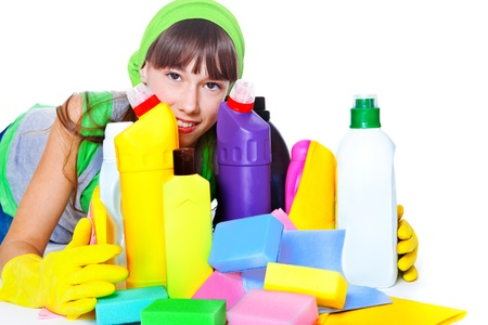cleaning products: Portrait of teenage girl behind cleaning products