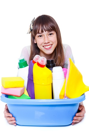 housecleaning: Cheerful girl holding basin with cleansers Stock Photo