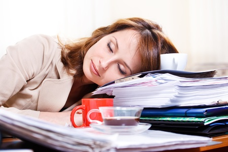 test paper: Tired young woman sleeping on the table