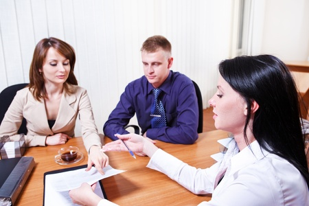 bank manager: Customers discussing contract issues with their consultant