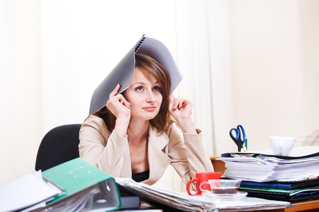 Upset stressed young woman at  work