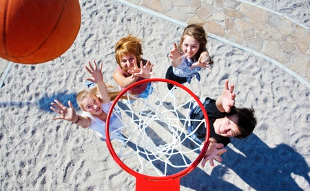 play boy: Basketball hoop and teenagers catching the ball under it