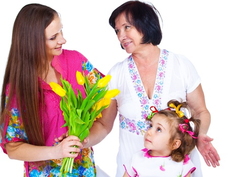 Young woman giving flowers to the senior one Stock Photo - 13252285