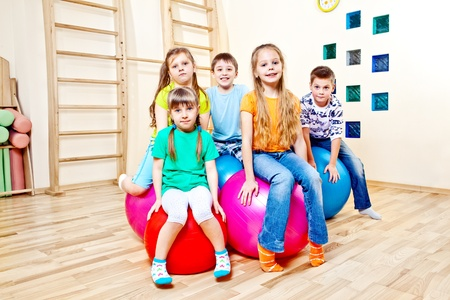 play school: Children sitting on large gymnastic balls
