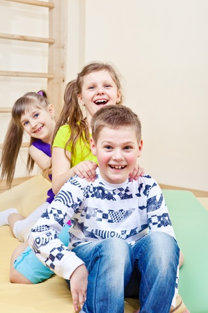 Laughing children indoors photo