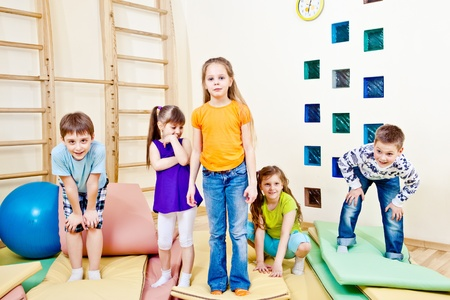 school activities: Playful children in the school gym