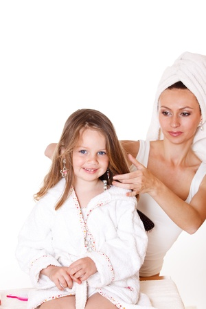 terrycloth: Mother brushing her little daughters hair Stock Photo