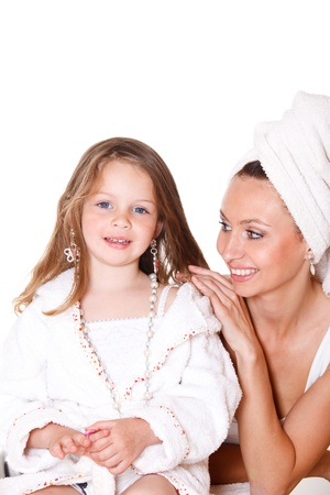 little girl bath: Happy daughter in a bathrobe and cheerful mother looking at her