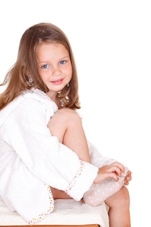 Sweet preschool girl in a white bathrobe photo