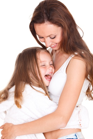 Laughing girl embracing her mother photo