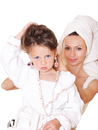 terrycloth: Smiling mother styling little girls hair