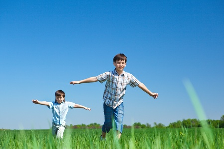 children running: Kids playing in the meadow