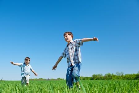 Joyful kids running in the countryside photo