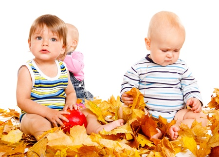 Babies group playing with leaves photo