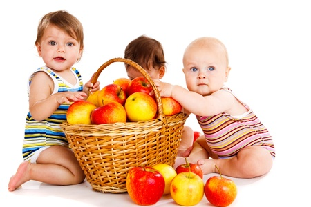 Three babies playing with apples photo