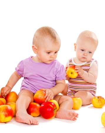 Healthy babies with red apples photo