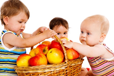 Baby friends with apples basket photo