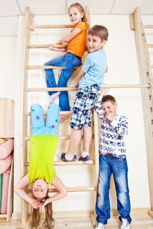 Happy primary school students in gym Stock Photo - 13975997