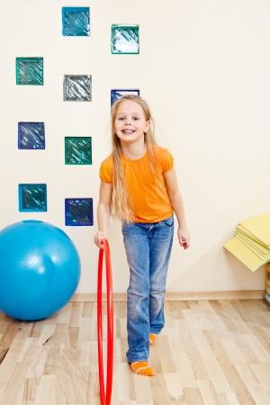 Elementary aged girl in a school gym photo