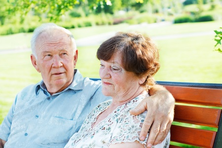 Two serene mature people together in park photo