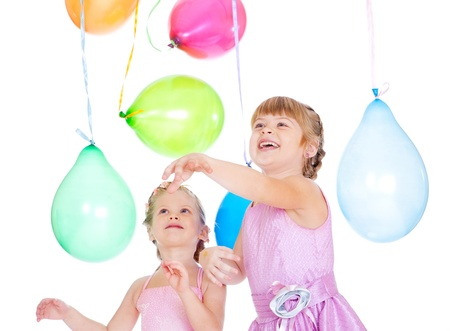 Cheerful siblings playing with balloons photo