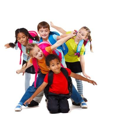 学校のグループの子供のバックパックと高齢者 写真素材