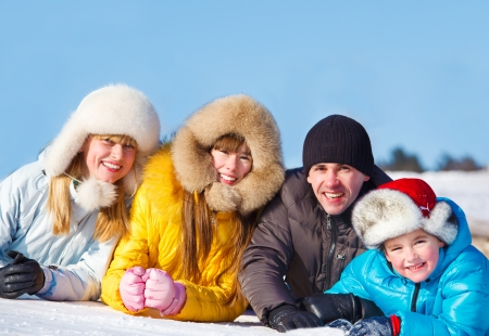 Joyful family in winter day photo