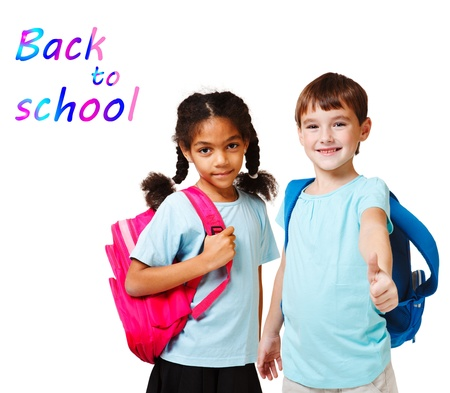 school aged: Two school kids in blue t-shirts with backpacks Stock Photo