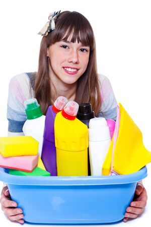 housecleaning: Beautiful smiling teenage girl with cleaning agents