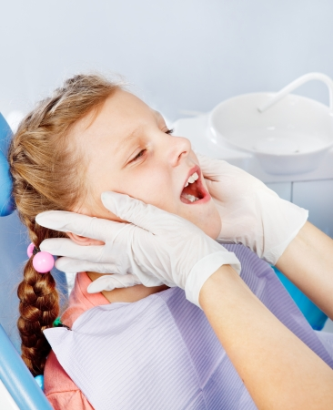 regular people: Portrait of a kid in dentist examination room Stock Photo